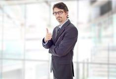 Pollice dell'uomo d'affari in su fotografia stock