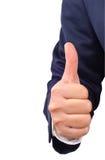 Pollice dell'uomo di affari sul segno della mano Fotografie Stock