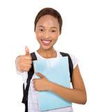 Pollice della studentessa di college su Immagine Stock