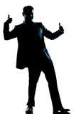 Pollice integrale dell'uomo della siluetta doppio su Fotografia Stock