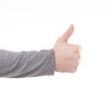 Pollici della mano dell'uomo sul segno isolato Fotografia Stock