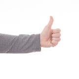 Pollici della mano dell'uomo sul segno isolato Immagini Stock Libere da Diritti