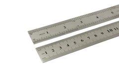 Pollici e centimetri di righello del metallo Immagini Stock