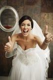 Pollici felici della sposa su Fotografia Stock