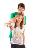 Pollici isolati della sorella e del fratello su e giù Fotografia Stock