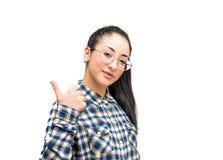 Pollici sorridenti della ragazza dell'adolescente su isolati Immagini Stock Libere da Diritti