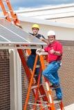 Pollici in su per energia solare Immagine Stock