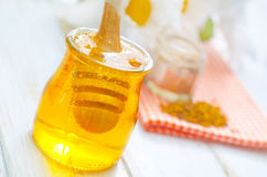 Polline e miele Immagine Stock