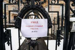Polling station sign on the gate of Consulate General of the Rus Royalty Free Stock Photo
