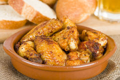Pollo al Ajillo - czosnku kurczaka skrzydła Obrazy Stock