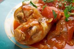 Pollo alla Cacciatora. Means hunter in Italian. In cuisine, alla cacciatora refers to a meal prepared hunter-style with tomatoes, onions, herbs, often bell Royalty Free Stock Photo