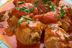 Pollo alla Cacciatora. Means hunter in Italian. In cuisine, alla cacciatora refers to a meal prepared hunter-style with tomatoes, onions, herbs, often bell Royalty Free Stock Images