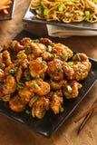 Pollo arancio asiatico con le cipolle verdi Immagini Stock