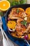 Pollo arrostito con le arance e le erbe Immagine Stock