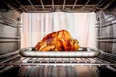 Pollo arrosto nel forno Fotografia Stock Libera da Diritti