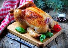 Pollo arrosto su una tavola di legno Fotografia Stock