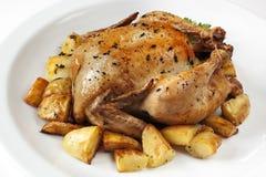 Pollo asado y patatas Fotografía de archivo libre de regalías