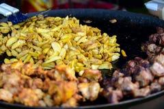 Pollo, carne di maiale e patata della griglia Fotografie Stock Libere da Diritti