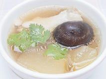 Pollo cinese della minestra con la zucca ed il fungo Fotografia Stock