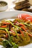 Pollo cocido al horno con la salsa de curry Imagen de archivo