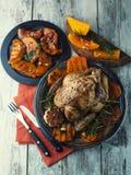 Pollo con la zucca ed i rosmarini Fotografia Stock