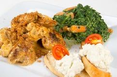 Pollo con salsa ed il contorno Fotografia Stock