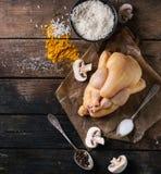 Pollo crudo con condimento e riso Fotografia Stock