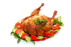 Pollo de carne asada con los vehículos Imagen de archivo libre de regalías