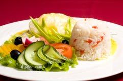 Pollo de Gratinéed con risotto imagen de archivo