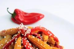 Pollo del sesamo con pepe rosso Fotografie Stock