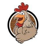 Pollo divertido de la historieta en una insignia Foto de archivo