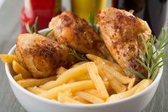 Pollo e fritture Fotografia Stock