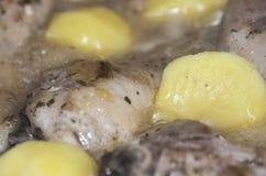 Pollo e patate Immagini Stock