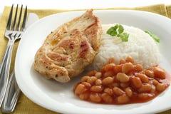 Pollo frito con arroz y habas Imagen de archivo