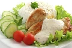 Pollo frito con la salsa y el arroz Foto de archivo libre de regalías