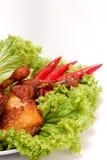 Pollo frito en la decoración Imagenes de archivo