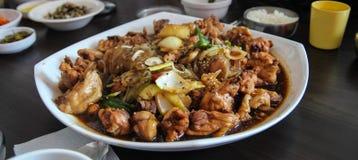 Pollo fritto con la cipolla Immagini Stock