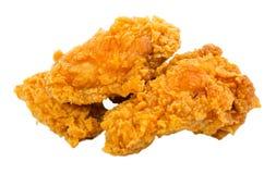 Pollo fritto nel grasso bollente isolato su fondo bianco Fotografia Stock Libera da Diritti