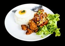 Pollo piccante con riso e l'uovo fritto Fotografie Stock