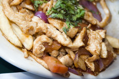 Pollo saltado Stock Photography