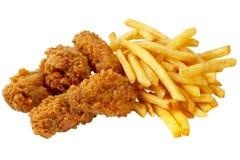 Pollo y patatas fritas Imágenes de archivo libres de regalías
