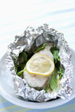 Pollock and lemon cooked in aluminium foil Royalty Free Stock Photography