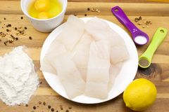 Pollock raw sliced fish. And other ingredients for frying stock photography