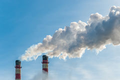 Pollute the atmosphere. Smoke from the chimneys pollute the atmosphere Stock Photo