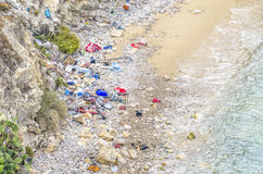Polluted beach in Ibiza. Stock Photo
