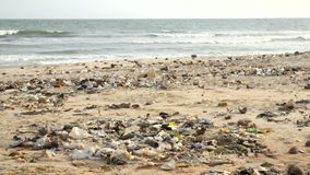 Polluted beach with plastic bottles stock footage