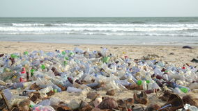 Polluted beach with plastic bottles stock video footage