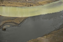 Polluted black and yellow green rivers Stock Image