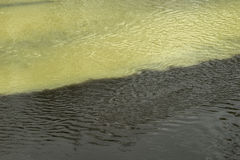 Polluted black and yellow green rivers Royalty Free Stock Photo