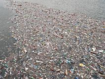 Polluted lake. Pollution in water. Plastic bottles. Diseases and illnesses Stock Images